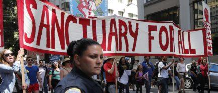 protesta marcha inmigrantes santuario