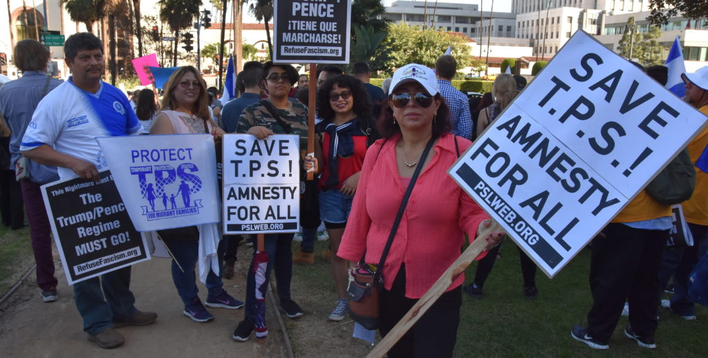 Activistas piden en marcha residencia permanente para beneficiados con TPS